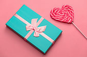 gift box and heart shaped caramel on a stick,selective focus