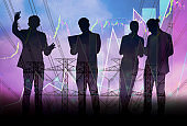 Double exposure effect- group of entrepreneurs,young businessmen stand informal discussions meeting,team work together,business and financial concepts,graph and performance charts and city background