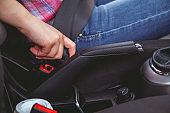Young beautiful woman driving a car seat belt