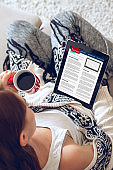 Woman reading news on tablet