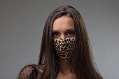 Woman wearing an animal print face mask