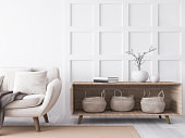 Stylish living room interior with wooden coffee table, plant tow empty frames and elegant accessories. Stock photo