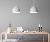 Minimal design for dining room, natural wooden furniture on gray wall