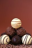 Chocolate candies set.White and black chocolate truffles in grated chocolate