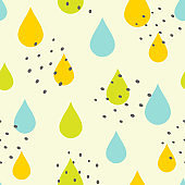 Cute seamless pattern with colored raindrops and small spots. Rainy print for children. Vector illustration.