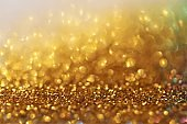gold glitter glow background. gold shiny texture.New Year and Christmas background.Wallpaper phone shining glitter.glitter macro background with shining bokeh.Shining texture