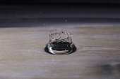A small water drop fall on water surface