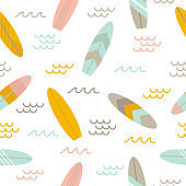Summer seamless pattern with surfboards. Cute sea background. Flat style design