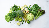 Banner composition with healthy vegetarian meal ingredients. Raw food concept. A variety of organic fruits and vegetables with avocado. Vegan menu