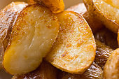 Baked fried roast potato with golden crust