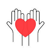 Charity, volunteering and donating concept. Raised up human hands with red heart. Children's hands are holding heart symbols. Charity and donating logo