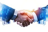 business man shaking hand with global network link connection, graph chart stock market graphic diagram and city background, digital technology, internet communication, teamwork, partnership concept