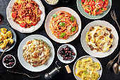 Pasta, many different varieties, shot from the top on a black background