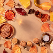 Square autumn frame with copy space, with vibrant fall leaves, wine, and cookies, overhead flat lay shot