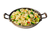 Vegetable rice in a pan, isolated on a white background with a clipping path. Broccoli, green peas, and carrots