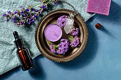 Aromatherapy products, shot from the top with a place for text. Essential oil, scented candle, incense cone and aromatic soap, infused with vervain and lavender