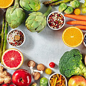 Healthy vegan food square banner with fruit, vegetables, legumes, mushrooms etc, shot from above with copy space