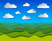 Scenic nature landscape of green grass meadow and clouds in the sky cartoon paper cut modern style vector illustration.