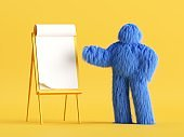 3d render. Funny hairy yeti toy, blue monster stands near the presentation easel board. Blank business mockup. Conference speaker concept. Clip art isolated on yellow background