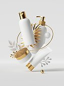 3d render, white cosmetic bottles with golden caps, isolated on white background. Beauty products and palm leaves levitate. Blank package: shampoo, soap, oil, cream, moisturizer. Commercial mockup