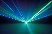 3d render, digital illustration. Bright projector shining on the empty stage, glowing laser rays, abstract neon light background, green blue disco lighting