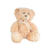 Light brown fluffy teddy bear toy isolated on white background