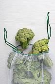 View from above on reusable bag full of green broccoli showing solicitous attitude to nature