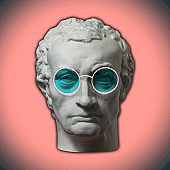 Contemporary art concept collage with antique statue head in a zine culture style. Male face with glasses.