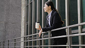 asian female boss having coffee break relax.