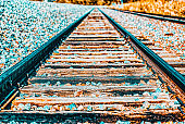 Old railway sleepers and rails in an American town.