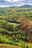 View of Lake Uchkol. Autumn taiga landscape