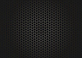 Abstract black hexagon pattern on glowing gold background and texture.