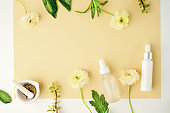 cosmetic beauty product with natural ingredient and flower.