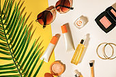 Beauty cosmetic product on flatlay background . Skincare for summer and travel.