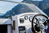 Steering wheel and dashboard of a pleasure boat. The view from the cab