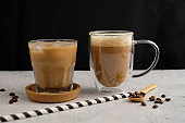 Coffee cup in variety , espresso, iced coffee and hot latte on black background, banner and advertisement. brew caffeine drink and modern style.