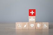 Health Insurance Concept,arranging wood block stacking with icon healthcare medical.