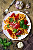 Penne pasta with tomato sauce and grilled bell pepper