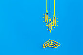 Great ideas concept with paperclip,thinking,creativity,light bulb on blue background,new ideas concept.