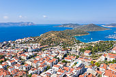 An aerial view of the bay of Kas in Antalya Turkey. Sea and town with an open sky.