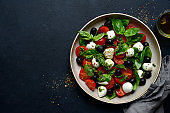 Caprese - traditional italian vegetable salad with mozzarella cheese