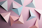 Abstract pattern made of colored paper, pink background