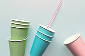 Paper disposable cups, blue background