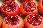 Pomegranates in the street shop, seeds and large group of fruit. Istanbul, Turkey.