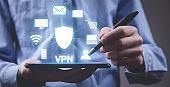 Man using digital tablet. VPN concept
