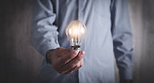 Man holding light bulb. Concept of inspiration and creativity