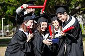 group happy graduates students