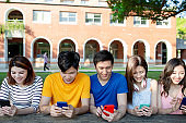 young students use smartphone
