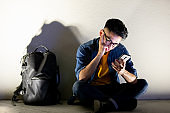 man upset while using phone