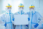 health workers show blank billboard